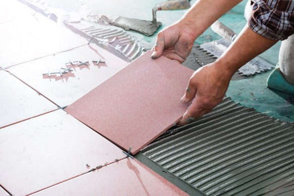 51918416 - installing tiles - professional mason