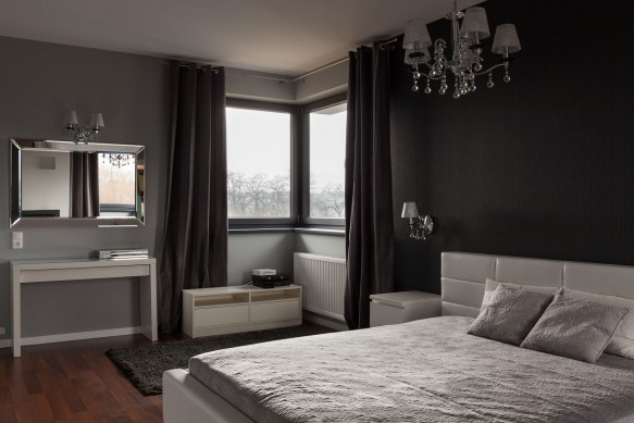 40260270 - dark expensive bedroom with black and grey walls